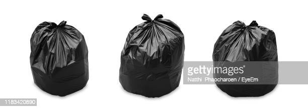 close-up of garbage bags against white background - bin bag stock pictures, royalty-free photos & images