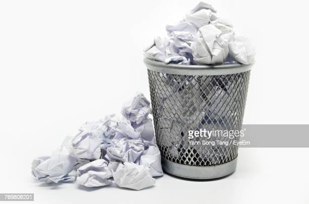 Close-Up Of Garbage Can Against White Background
