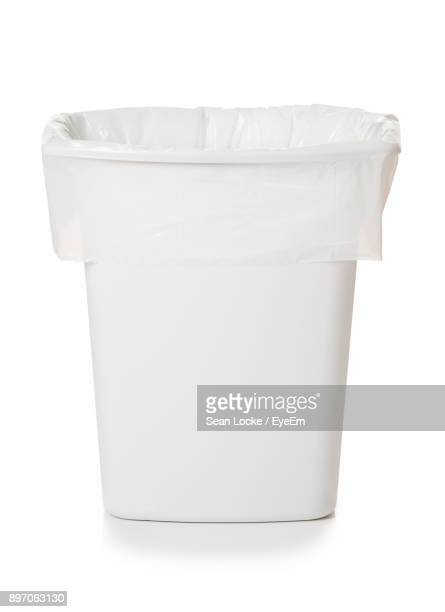 close-up of garbage can against white background - garbage bin stock pictures, royalty-free photos & images