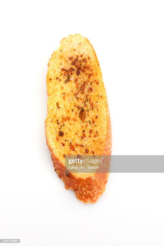 Close-Up Of Garlic Bread Against White Background : Stock Photo