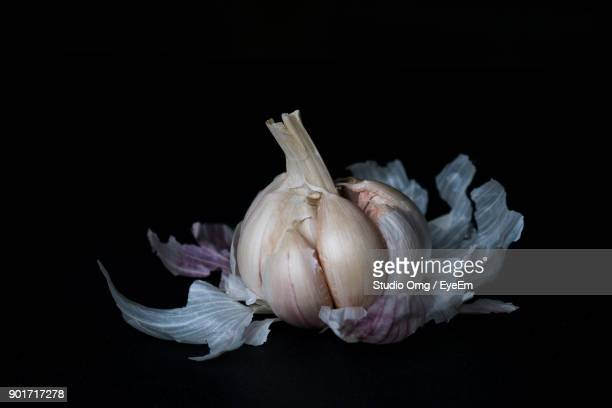 Close-Up Of Garlic Bulb Against Black Background