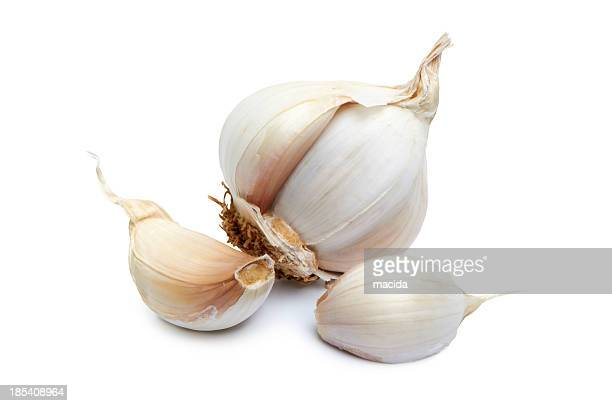 Close-up of garlic clove on white background