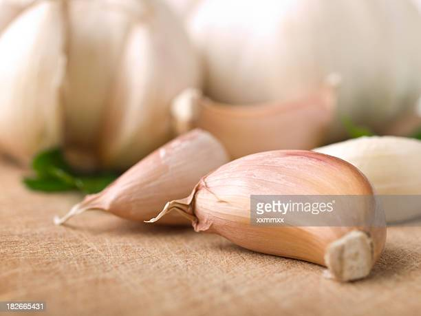Close-up of garlic cloves laying on a table