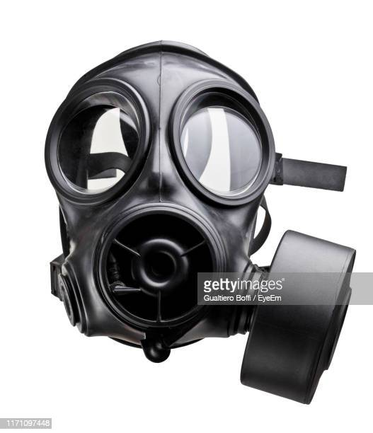 close-up of gas mask against white background - gas mask stock pictures, royalty-free photos & images