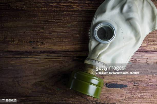 Close-Up Of Gas Mask On Wooden Table