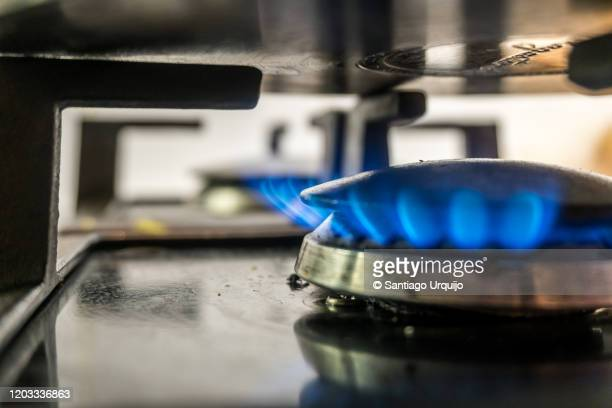close-up of gas stove burner and pot - capital region stock pictures, royalty-free photos & images