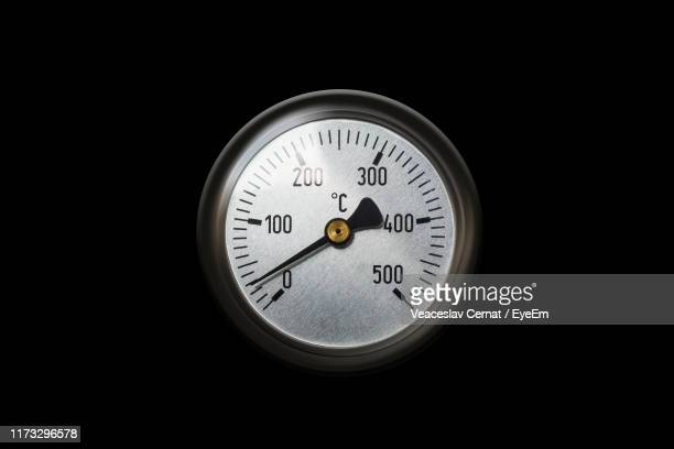 close-up of gauge on black background - gauge stock pictures, royalty-free photos & images