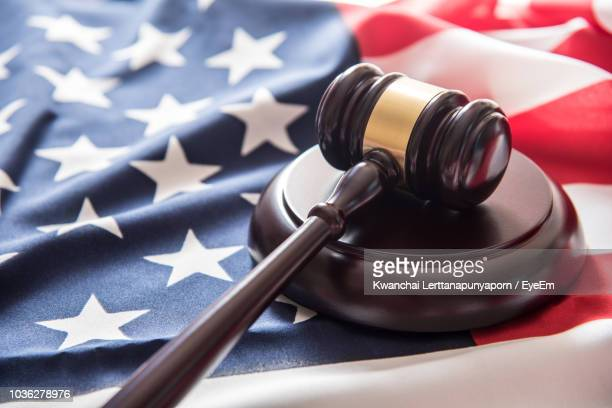 close-up of gavel on american flag - gavel stock pictures, royalty-free photos & images