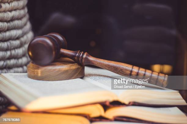 Close-Up Of Gavel On Books