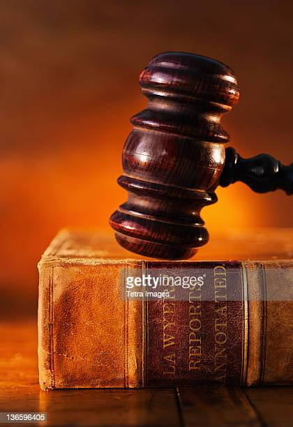 Close-up of gavel on lawyer book