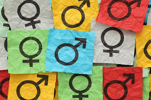Close-up of gender symbols on colorful paper 182152605