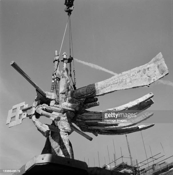 Close-up of Geoffrey Clarke's 12-foot aluminium sculpture of a winged cross, seen during the operation to lower it on to the 80ft bronze spire of...