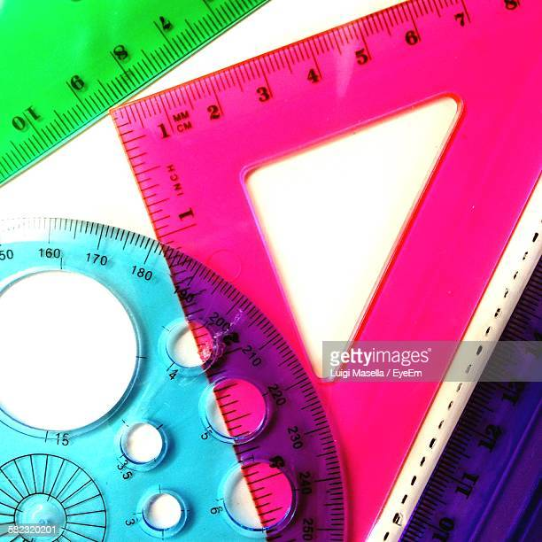 Close-Up Of Geometric Instruments Against White Backgrounds