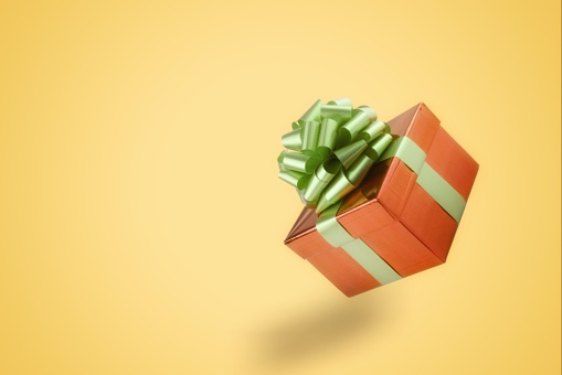Close-Up Of Gift Against Yellow Background - gettyimageskorea