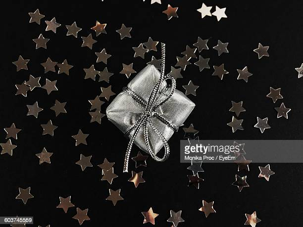 Close-Up Of Gift And Stars Black Background