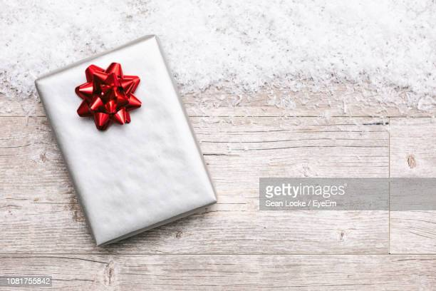 close-up of gift box and snow on table - fake snow stock pictures, royalty-free photos & images