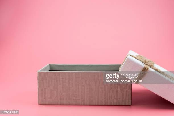Close-Up Of Gift Box Over Pink Background