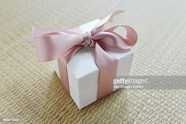 Close-Up Of Gift Box With Pink Ribbon