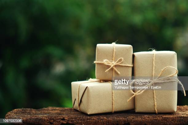 Close-Up Of Gift Boxes On Wood Outdoors