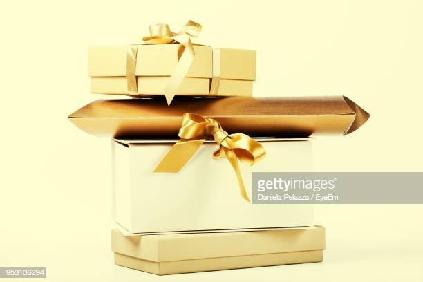 Close-Up Of Gift Boxes Over Beige Background