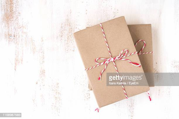 close-up of gift in box - brown paper stock pictures, royalty-free photos & images
