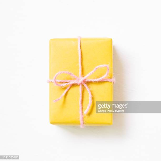 close-up of gift over white background - birthday present stock pictures, royalty-free photos & images