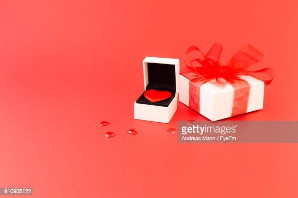 Close-Up Of Gifts Against Red Background