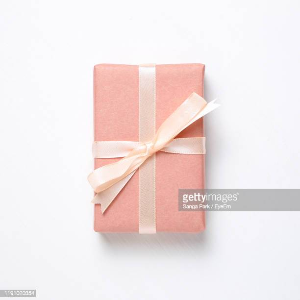 close-up of gifts on white background - gifts stock pictures, royalty-free photos & images