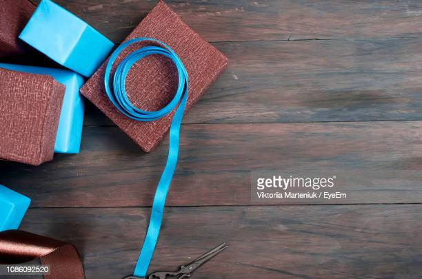 Close-Up Of Gifts With Blue Ribbons On Table
