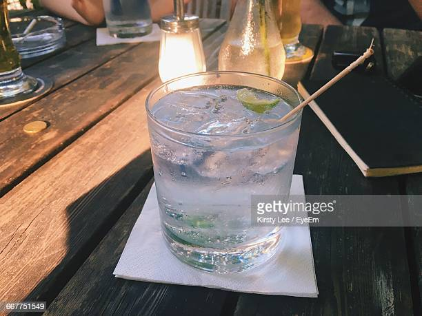 Close-Up Of Gin And Tonic On Wooden Table