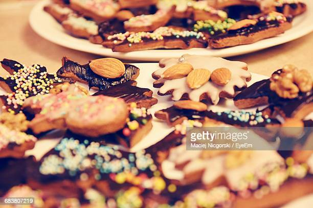 Close-Up Of Gingerbread Cookies In Plates On Table
