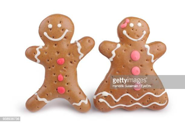 close-up of gingerbread cookies over white background - mannelijke gelijkenis stockfoto's en -beelden