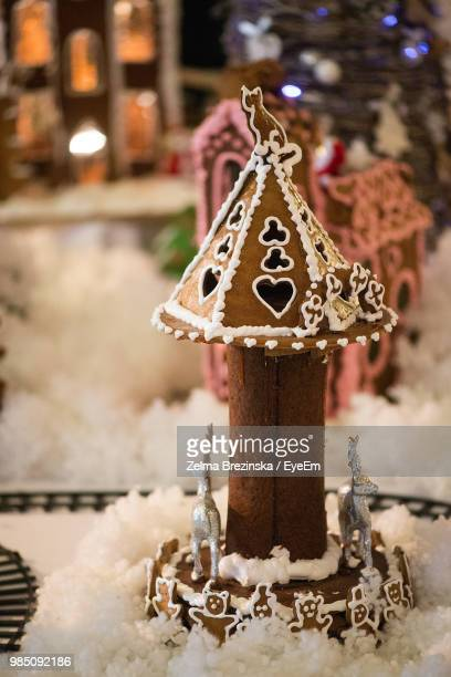 Close-Up Of Gingerbread House On Snow