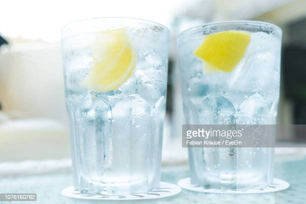close-up of gin-tonic in glass on table - cold drink stock pictures, royalty-free photos & images