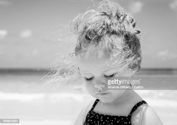 Close-Up Of Girl Against Sky During Sunny Day