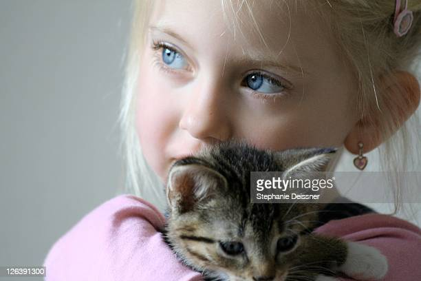 close-up of girl holding kitten - puss pics stock photos and pictures