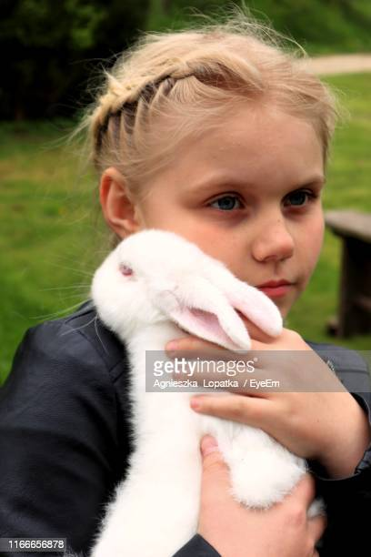 Close-Up Of Girl Holding Rabbit