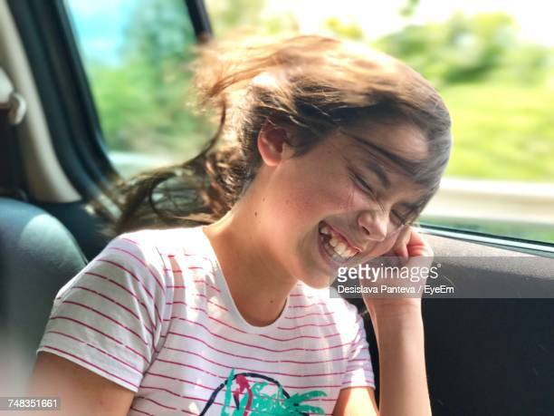 Close-Up Of Girl In Car