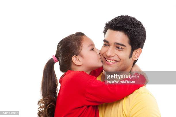 close-up of girl kissing her father - indian girl kissing stock photos and pictures