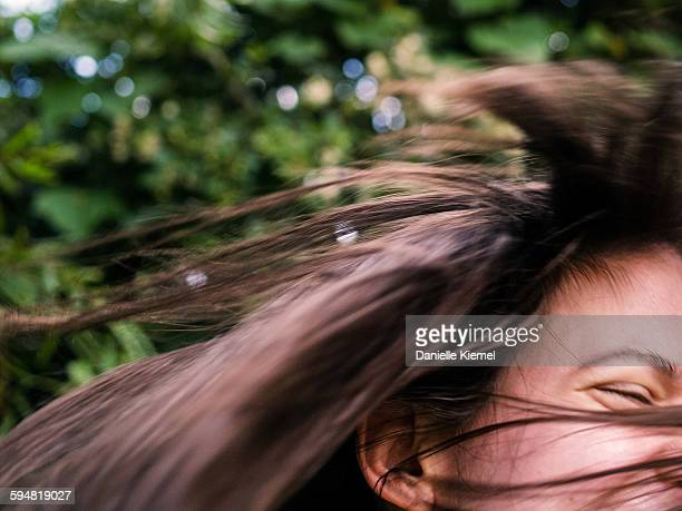 Close-up of girl laughing while turning head,