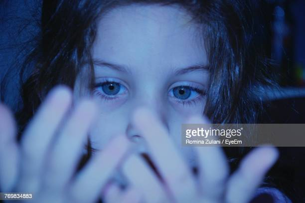 Close-Up Of Girl Looking At Hands