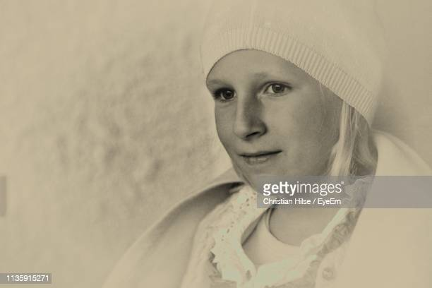 close-up of girl looking away - christian hilse stock-fotos und bilder