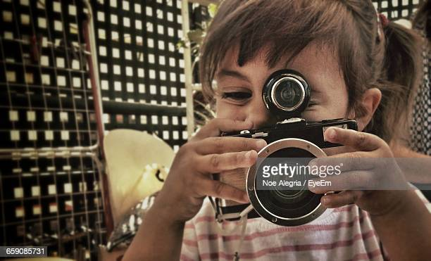 Close-Up Of Girl Photographing Using Camera