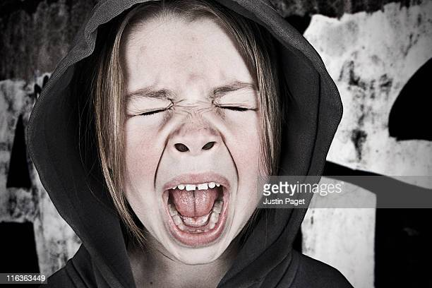 Close-up of girl (6-7) screaming