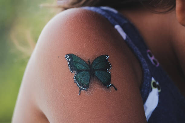 Close-Up Of Girl Shoulder With Fake Tattoo