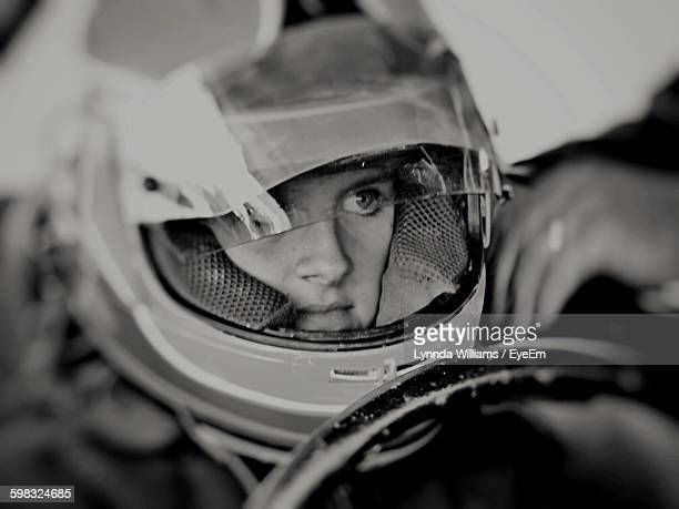 close-up of girl sitting in racing car - sports helmet stock pictures, royalty-free photos & images