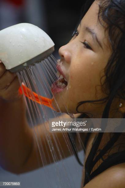 Close-Up Of Girl Taking Bath With Shower