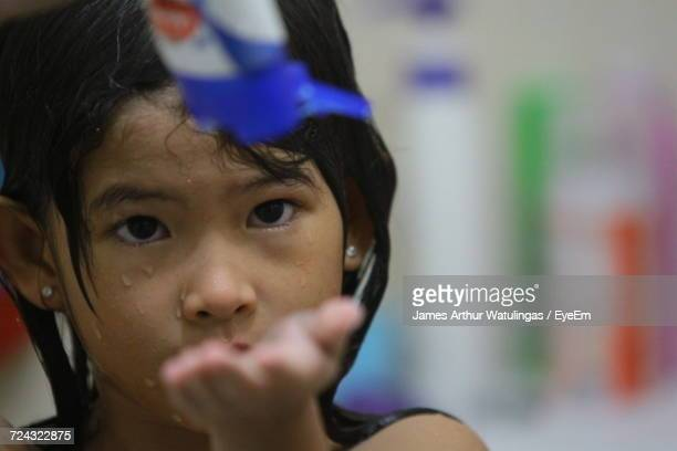 Close-Up Of Girl Washing Hair In Bathroom
