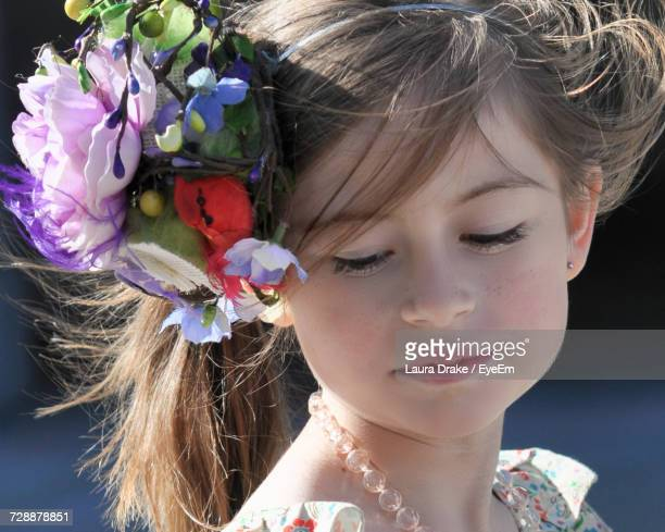 Close-Up Of Girl Wearing Flowers Looking Down