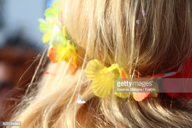 Close-Up Of Girl Wearing Flowers